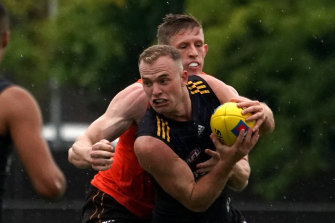 Tom Mitchell under pressure at Tuesday's practice match.