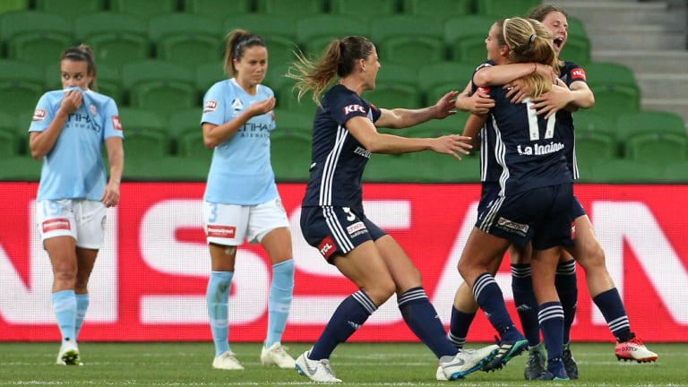 Melbourne Victory celebrate their first-half goal in a historic W-League derby against Melbourne City.