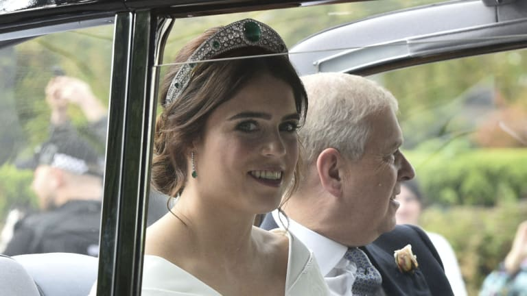 Princess Eugenie of York, left, arrives with her father Prince Andrew, Duke of York for her wedding with Jack Brooksbank in St George's Chapel, Windsor Castle, near London, England, Friday, Oct 12, 2018. (Ben Birchall/PA via AP)