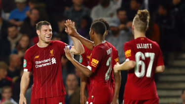 James Milner (left) led the way for a young Liverpool side.