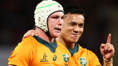 BRISBANE, AUSTRALIA - SEPTEMBER 18: Len Ikitau of the Wallabies celebrates with Michael Hooper of the Wallabies after receiving a penalty during The Rugby Championship match between the Australian Wallabies and the South Africa Springboks at Suncorp Stadium on September 18, 2021 in Brisbane, Australia. (Photo by Chris Hyde/Getty Images)