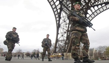 French soldiers patrol in front of the Eiffel Tower after the Charlie Hebdo attack.