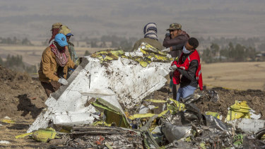 Rescue workers comb the scene of the Ethiopian Airlines crash. Nearly half of the airline deaths in 2018 and 2019 occurred during the two Boeing 737 Max crashes in Indonesia and Ethiopia.