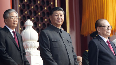 Chinese President Xi Jinping, centre, with former presidents Jiang Zemin, right, and Hu Jintao, left.