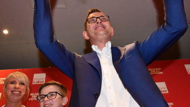 The Premier celebrates victory after his re-election.