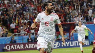 Lucky break: Diego Costa celebrates after scoring.