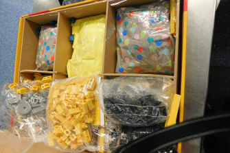 There are fears overworked airport staff will struggle to detect unlawful imports, such as this interception at Sydney airport in November.   It involved methamphetamine concealed in boxes of toys.