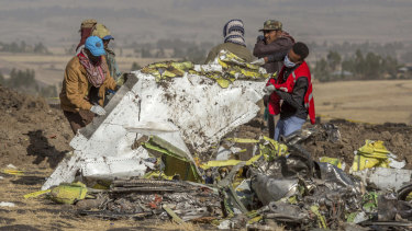 Rescuer at the scene of the Ethiopian Airlines crash. Boeing's 737 MAX planes have been grounded following the crash that cost 157 lives.