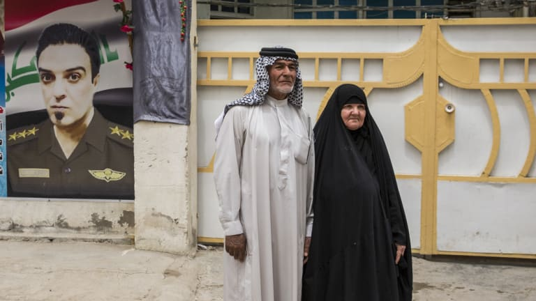 Abid al-Sudani with his wife, Laisa Hashim Shuaith, the parents of Captain Harith al-Sudani, outside their home in Baghdad, on May 8.