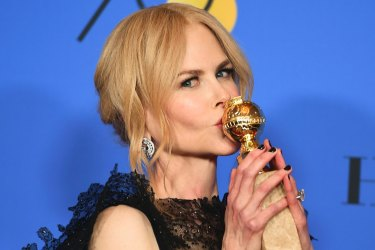 """Nicole Kidman poses in the press room with the award for best performance by an actress in a limited series or a motion picture made for television for """"Big Little Lies"""" at the 75th annual Golden Globe Awards at the Beverly Hilton Hotel on Sunday, Jan. 7, 2018, in Beverly Hills, Calif. (Photo by Jordan Strauss/Invision/AP)"""