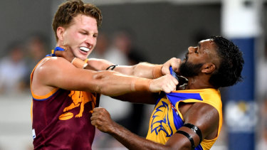 Alex Witherden (left) of the Lions grapples with Liam Ryan (right).
