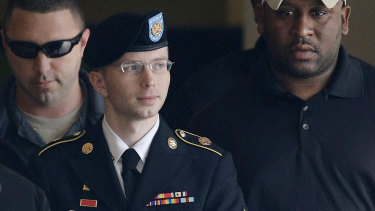 Army PFC, formerly Bradley Manning, is escorted to a security vehicle after his court martial for leaking classified material to WikiLeaks.