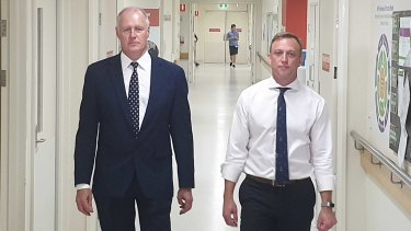 """Queensland Health Director-General John Wakefield (left), pictured with Queensland Health Minister Steven Miles, said """"none of these practices are perfect""""."""