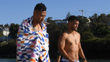 Folau and Hunt at a Waratahs recovery session in February at Clovelly Beach.