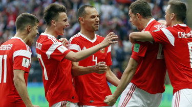 Raining goals: The Russians celebrate the third of the match, scored by Artem Dzyuba (second from right).