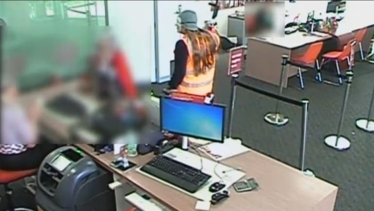 Masked thieves storm a Bendigo Bank branch in Laverton.