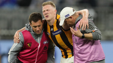 Crocked: James Sicily is assisted from the field during Hawthorn's loss to West Coast at Optus Stadium in Perth.