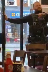 A police officer orders the evacuation of a cafe near the Streatham terrorist attack.