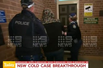 Mr Rumsby being escorted into Mudgee police station on Tuesday night.