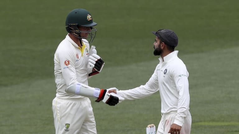 Fine contest: Kohli is congratulated by Josh Hazlewood after the final wicket fell.