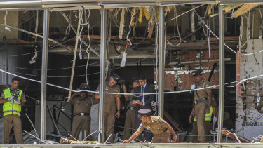Sri Lankan police inspect the scene at the Shangri-la hotel in Colombo.