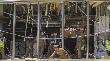 Sri Lankan police inspect the scene at the Shangri-la hotel in Colombo.