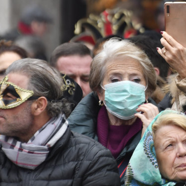 A number of tourists are wearing protective masks in Venice but the majority aren't.