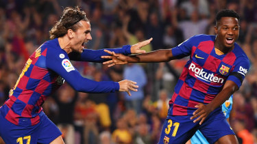 Sensation: Anssumane Fati of Barcelona, aged 16, celebrates with Antoine Griezmann after scoring his team's first goal during the Liga match against Valencia CF at Camp Nou.