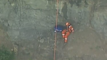 A specialist paramedic descended the cliff face to reach the site of the crash.
