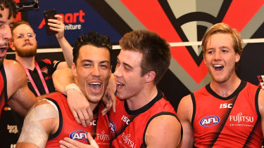 Essendon's Tom Bellchambers, Zac Clarke, Dylan Shiel, Andrew McGrath and Darcy Parish celebrate their win over Melbourne  at the MCG.