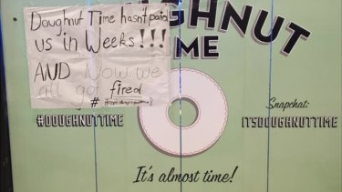 A handwritten sign on the wall of the Doughnut Time store at Sydney\'s Queen Victoria Building displays worker anger.