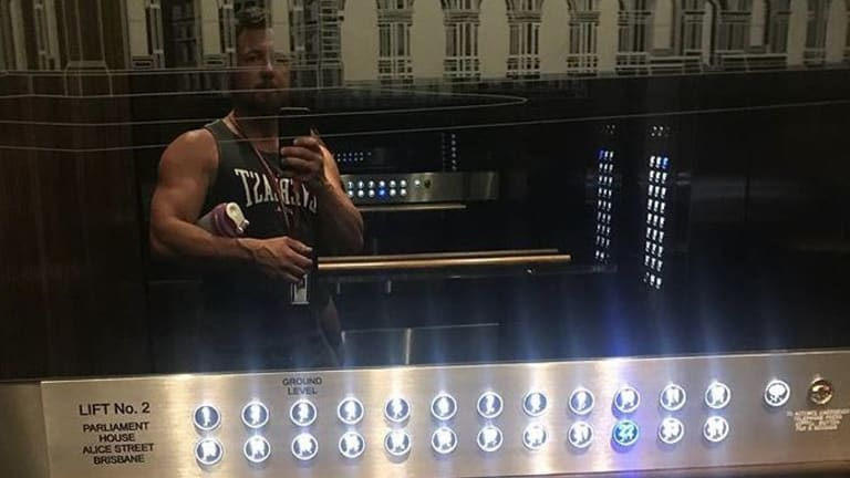 Nick Dametto snaps a selfie in the Queensland Parliament lift.