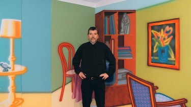 Howard Arkley in front of his work in the Australian pavillion at the Venice Biennale in June 1999, just a few weeks before his death