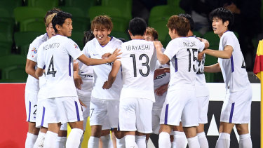 Off the mark: Taishi Matsumoto (third from left) reacts after opening the scoring for Hiroshima.