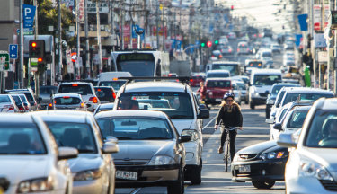 A cyclist making their way along Sydney Road, one of the most dangerous routes in the city.
