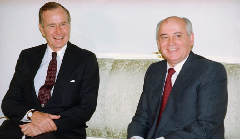 """An October 29, 1991 photo US President George H. W. Bush with Soviet President Mikhail Gorbachev after meeting in Madrid, Spain. Gorbachev expressed his """"deep condolences"""" to all Americans following Bush's death."""
