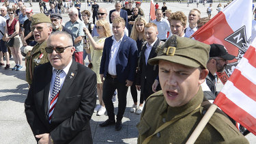 Polish officials and war veterans pay tribute to a World War II-era underground force that collaborated with the Nazi towards the end of World War II.