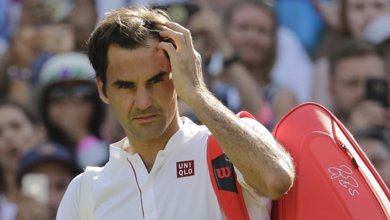 Head scratcher: Roger Federer became a surprise victim of the Wimbledon semi-finals.