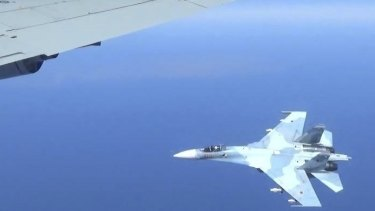 A Russian jet coming within a few feet of a US Air Force reconnaissance jet over the Baltic Sea last year.