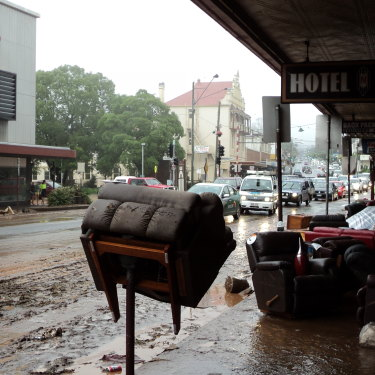 An armchair sits impaled on a parking meter opposite Rowes in Russell Street the day after the January 10 floodwaters rushed through the regional city in 2011.