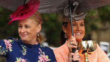 Lord mayor Sally Cap and VRC chair Amanda Elliott parade with the Melbourne Cup on Monday.