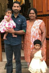Priya and Nades with their daughters.