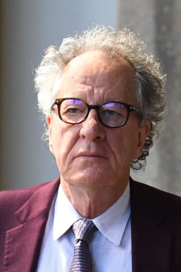 Geoffrey Rush arrives at court.