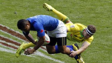 Flying effort: Malouf tackles Samoa's Alamanda Motuga at the London Sevens in 2017.