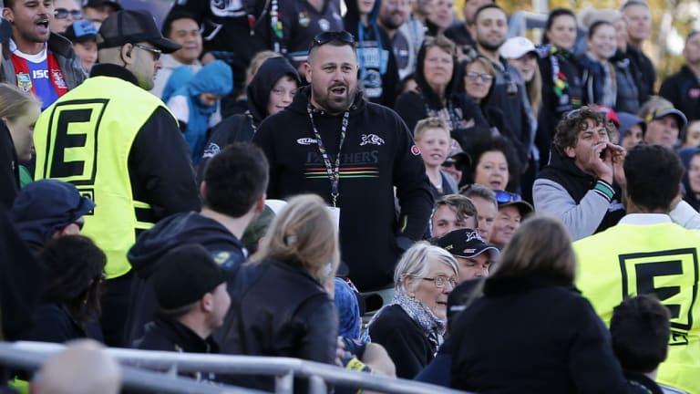 Silly season: A Panthers fan is ejected from the ground after allegedly throwing a ball at the head of Knights player Aiden Guerra.