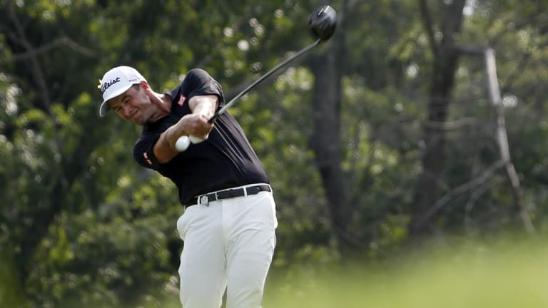 Red hot: Adam Scott flew into contention on day two.