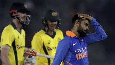 Circumspect: Indian skipper Virat Kohli (right) is more concerned with the World Cup than the series loss to Australia.
