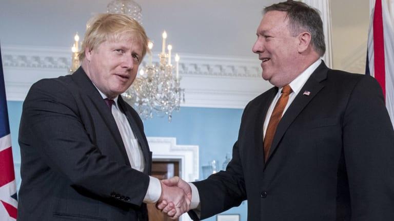 US Secretary of State Mike Pompeo shakes hands with UK Foreign Secretary Boris Johnson in Washington.