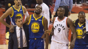 Durant (No.35) is helped from the court in the first half.