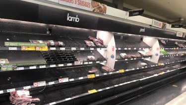 Regional supermarkets, like this Coles in Gisborne, are being cleared of supplies by desperate city-based shoppers.